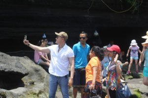 a group selfie at tanah lot temple