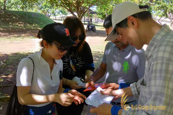 Endered Group is reading a clue during treasure hunt game in Water Blow Nusa Dua